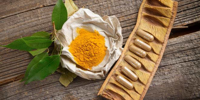 Powdered Curcumin and filled capsules.
