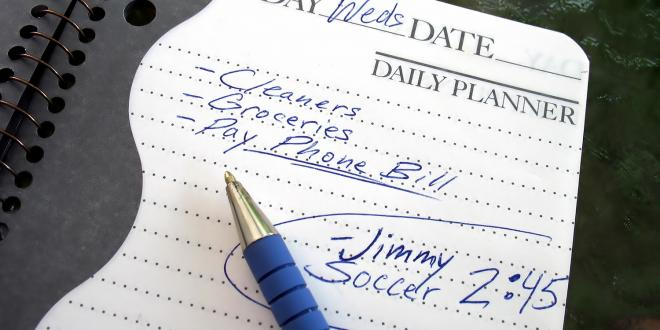 A daily planner filled with chores and notes about kids